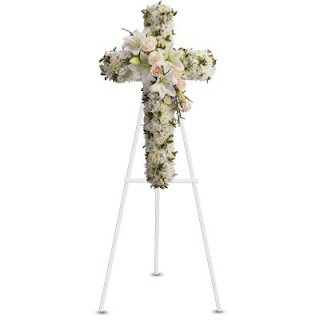 Send Sympathy Flowers with the Divine Light Cross by Teleflora
