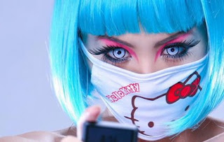 Goth girl wearing weird Hello Kitty face mask