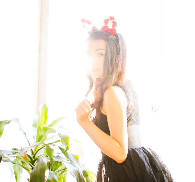 Vancouver Fashion blogger Jasmine Zhu wearing garden bunny ears and black lace puffy dress