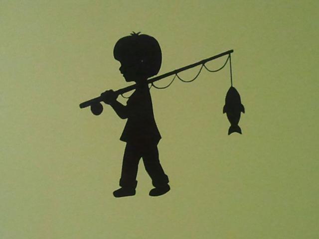 Boy fishing silhouette