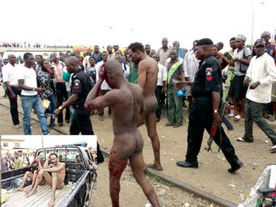 Photos of Men Mistaken As Human Eaters Almost Burnt To Death in Lagos