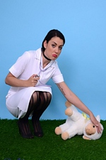 Sexy brunette Pin-Up Bryoni-Kate Williams strips as a naughty vet! Pin-Up Wow