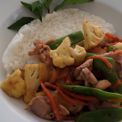 Lemon Grass Chicken Stir Fry:  Chicken pieces flavored with lemongrass and chilies then stir fried with vegetables and served with rice.