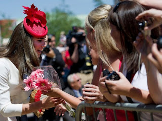 Kate, Duchess of Cambridge, is guarded by security as she greets royal fans after visiting the Museum of Civilization in Gatineau, Canada on Friday, July 1, 2011.