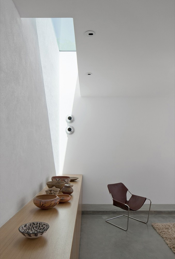 minimal white interior with ceiling window