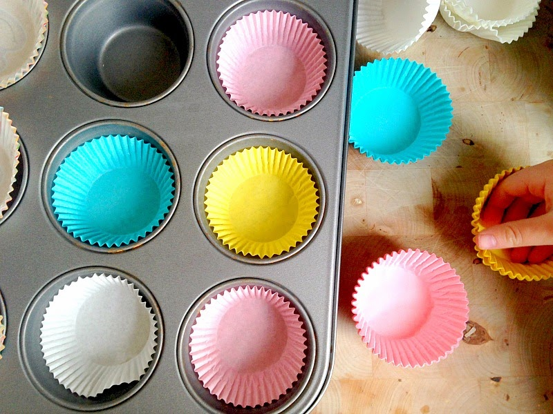 coloured cupcake cases in baking tray