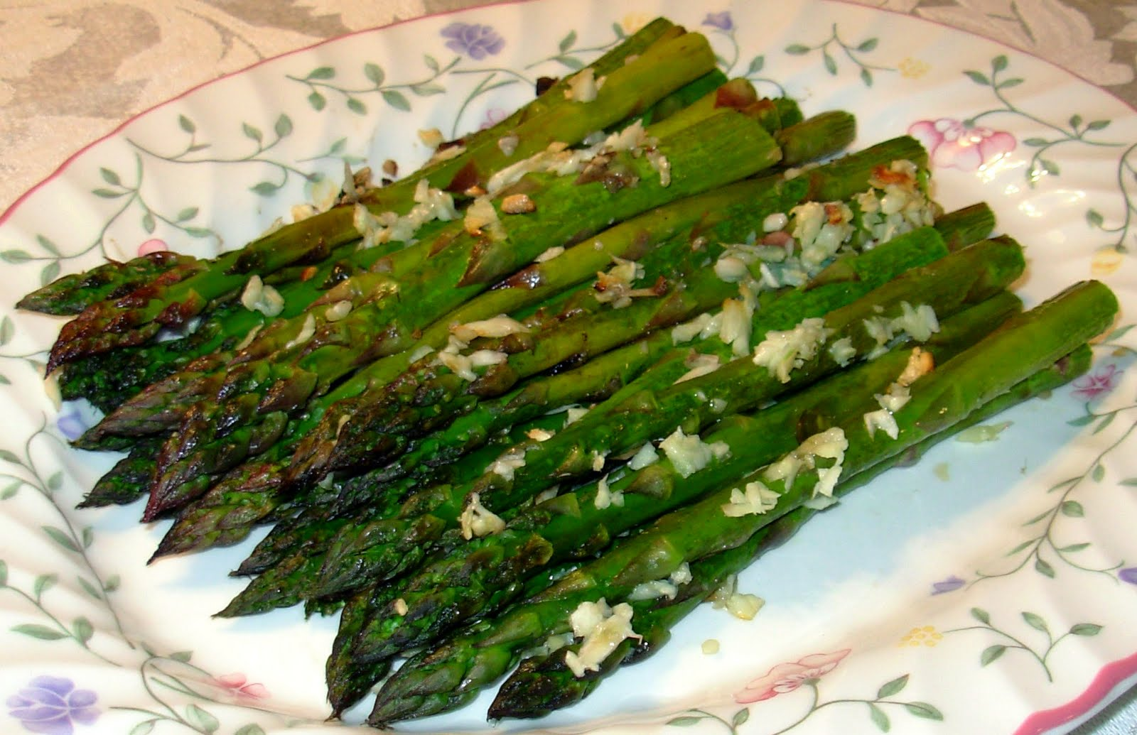 Roasted Asparagus is basted with olive oil, sprinkled with garlic