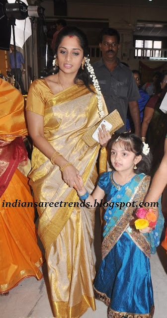 Shalini Ajith kumar in traditonal gold color silk saree along with her ...