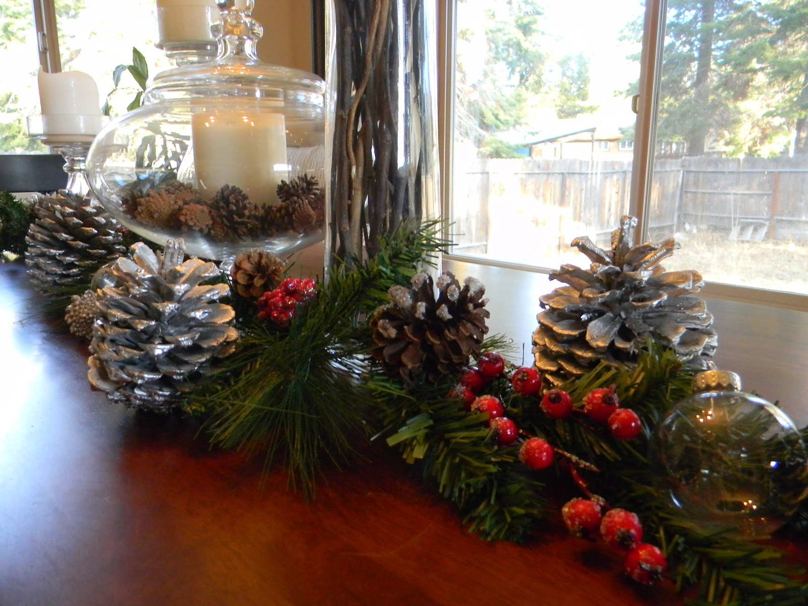 the garland was pre made from rite aid i spray painted some pinecones plucked from our front yard silver which adds a great metallic detail