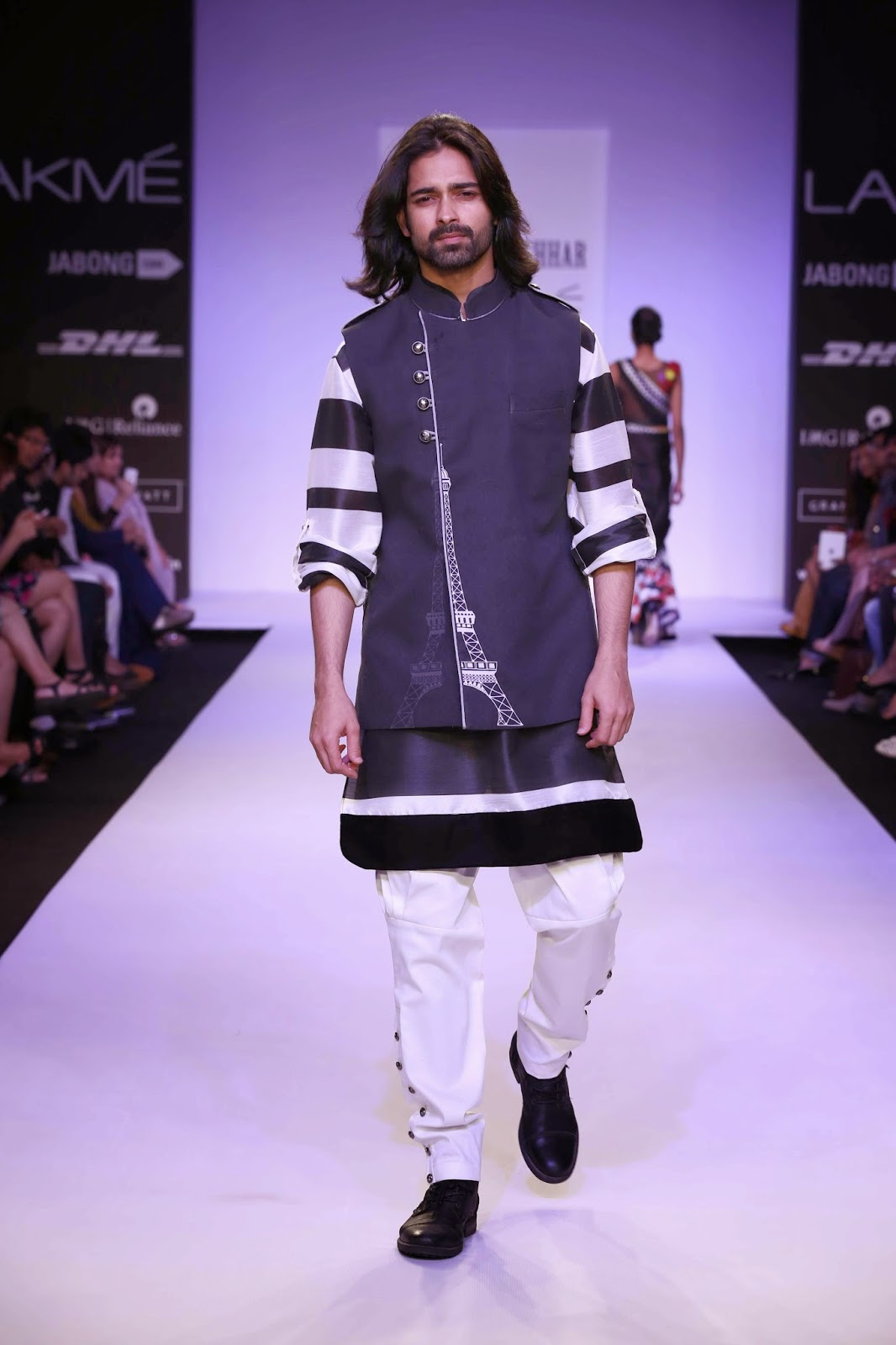 Men's wear worked well in black/white with ombré effects for kurtas, horizontal striped bundgalas, bundi with an Eiffel tower print, or asymmetric closures.