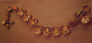A fifteenth-century rosary of hollow agate beads, each of which opens, revealing a scene in enameled gold. The rosary illustrates the elaborate materialism of the late medieval period, a source of controversy within the Church. Length, 51 cm. Muse National du Louvre, Paris