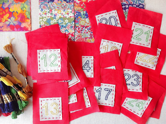 hand-stitched numbers on advent calendar pockets