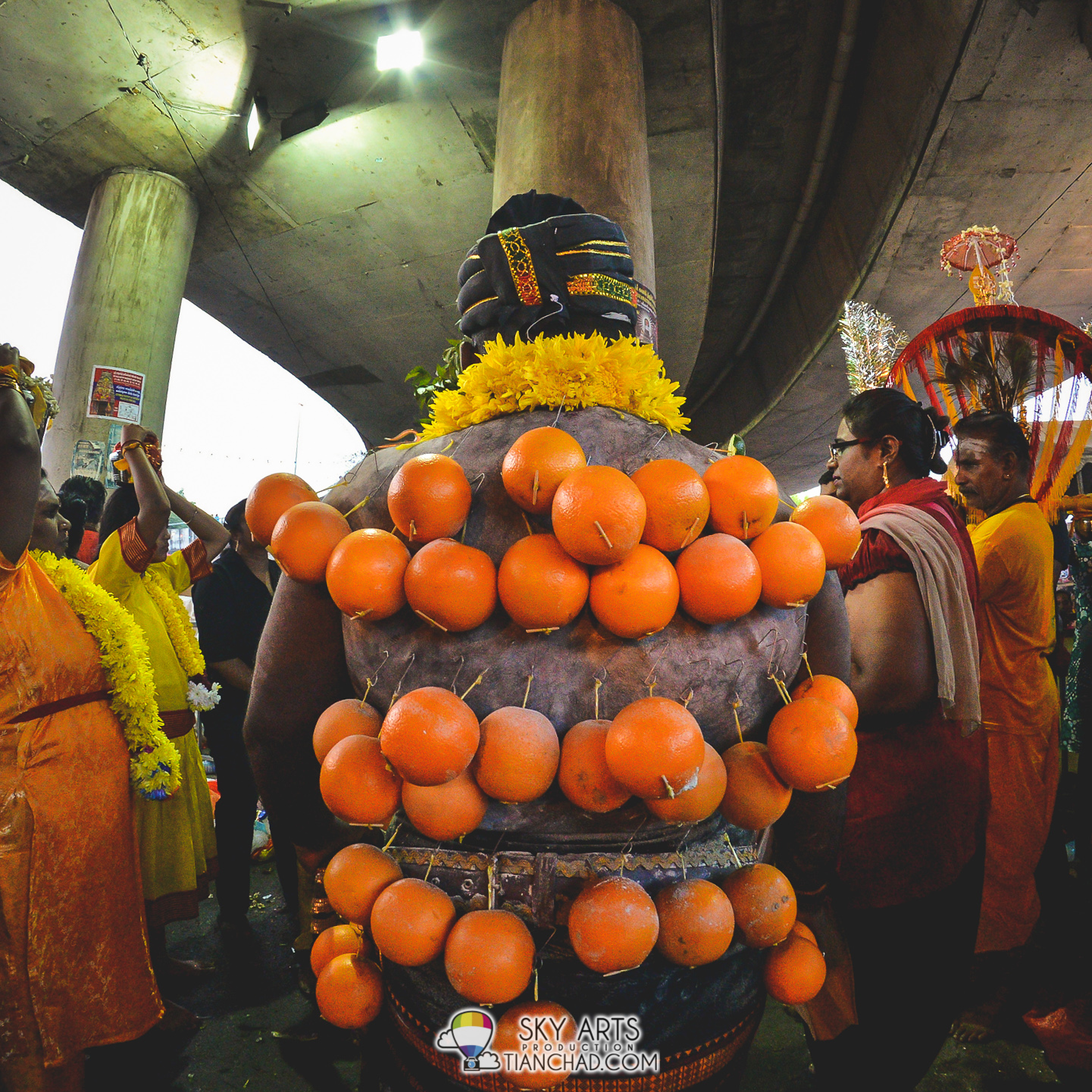 Saw oranges hanging at the back of a devotee
