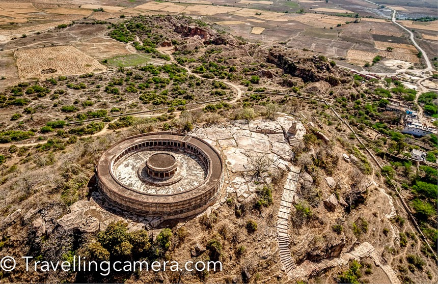 Last year I was out in Morena district of Madhya Pradesh and got to explore some very interesting places. Although it was summer season but uniqueness of these places made the visit worth.There are stories associated that architecture of Indian Parliament is inspired from the Chausath Yogini Temple in Mitawali (Mitaoli). This campus is in circular shape, as you can see these photograph. There is an outer region with 64 ('chausath' in hindi) pillars and a temple in the middle. Between the pillars, there are various small temples.There are other Chausath Yogini Temples in other parts of India. I have been to the other one in Jabalpur (Madhya Pradesh)  and that's also similar, but probably smaller in size. Other Yogini temples are situated in Ranipur Jharial & Hirapur in Orissa and Khajuraho.As you can see in these photographs, this place is situated in dry region. One needs to trek to reach the temple, although the path is very well maintained.Chausath Yogini Temple, Mitawali AKA Ekattarso Mahadeva Temple, Mitaoli is dedicated to chausath yogini. This circular structure has 170 feet radius, located on 100 feet mountain.