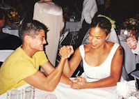 Stephanie Kuehn arm-wrestling her boss at her wedding