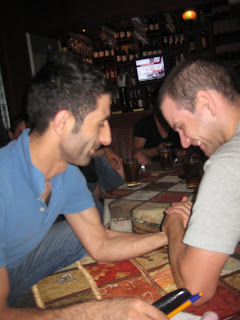Anthony arm-wrestling with our server.