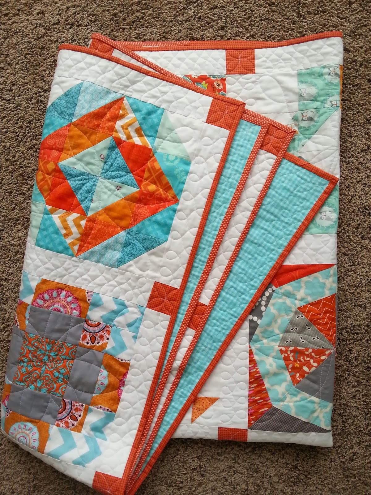 Aqua and Orange Sampler Quilt Folded