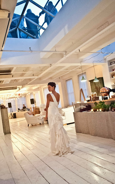 A Model Wedding, bustling a wedding dress at Gary's Lofts