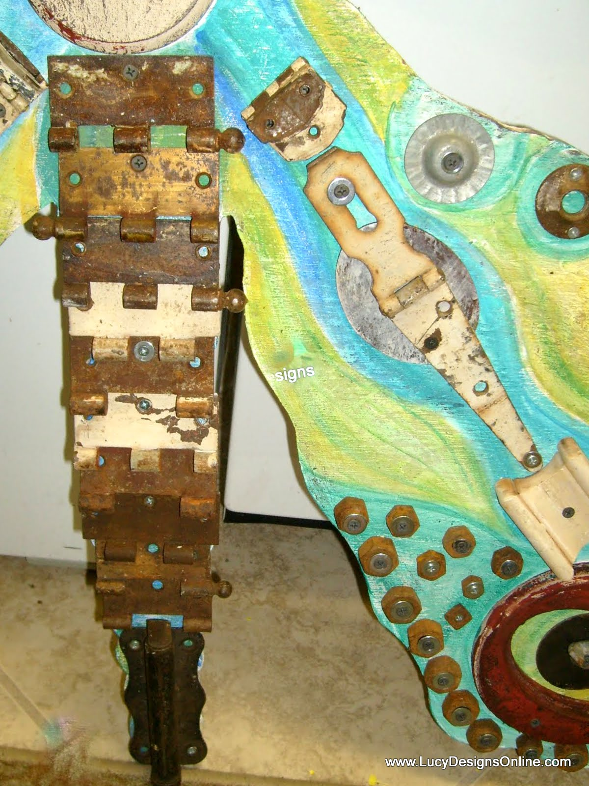 giant butterfly art with rusty hinges and washers