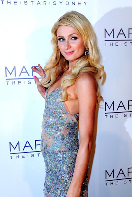 gorgeous looks & : paris hilton posses at the opening of marquee night club