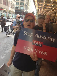 PDA members like Bill Bianchi protested outside of ALEC's 40th annual meeting in Chicago.