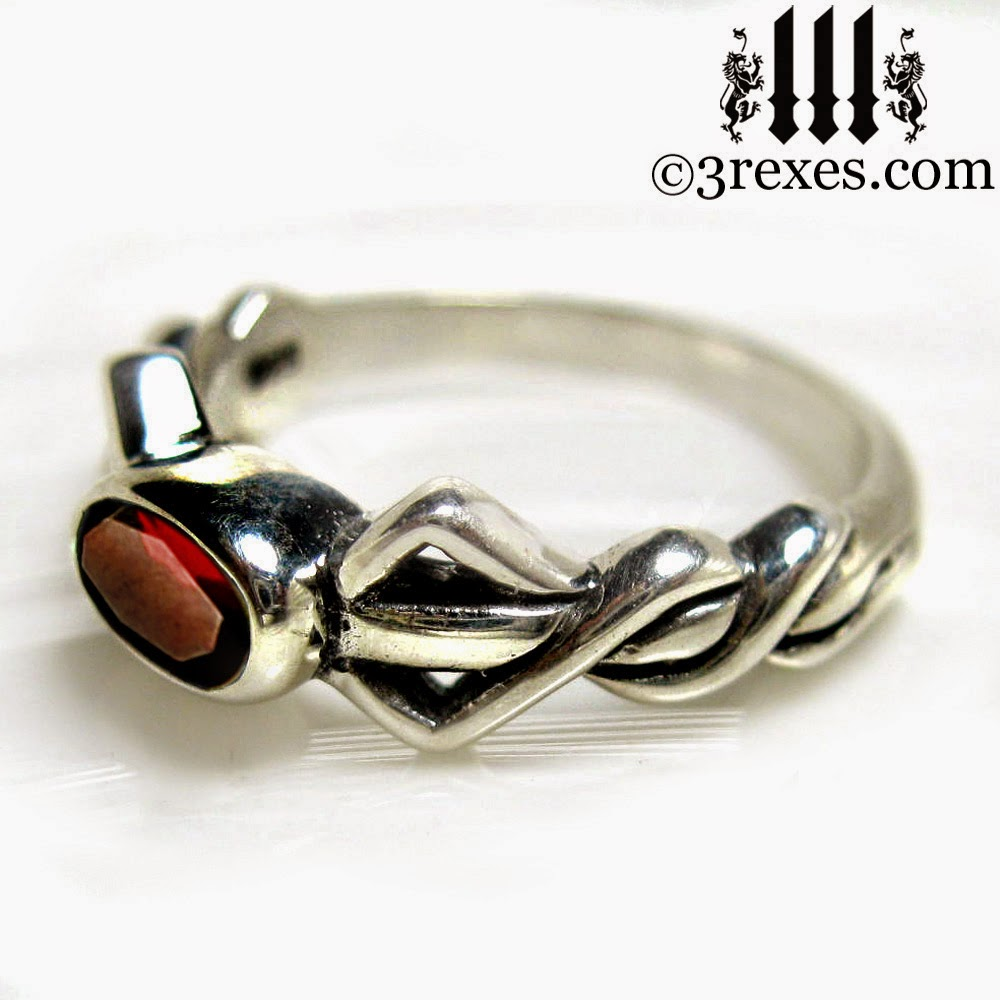 silver pixie ring with garnet stone
