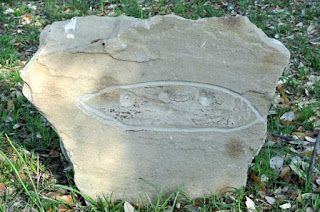 Grave marker of alien buried in Aurora cemetery