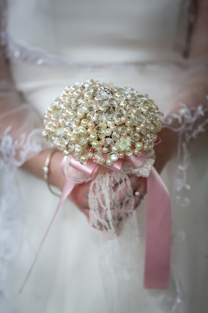 Pearl and crystal bridal bouquet with pink and lace