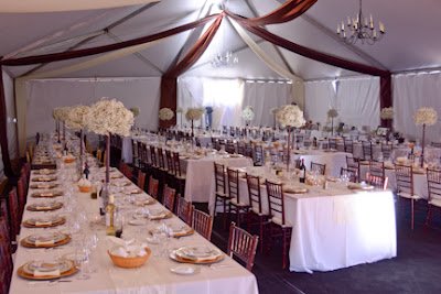 Wedding reception tent with draping and chandelier