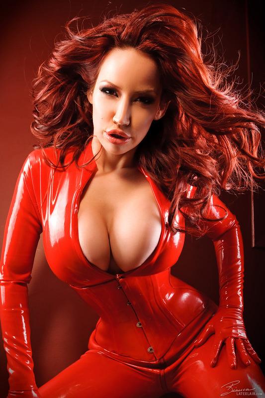 In latex woman redhead