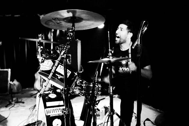 The Rural Alberta Advantage drummer Paul Banwatt singing and drumming at Hi-Dive