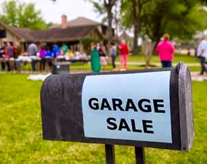 Garage Sale sign advertising a yard sale