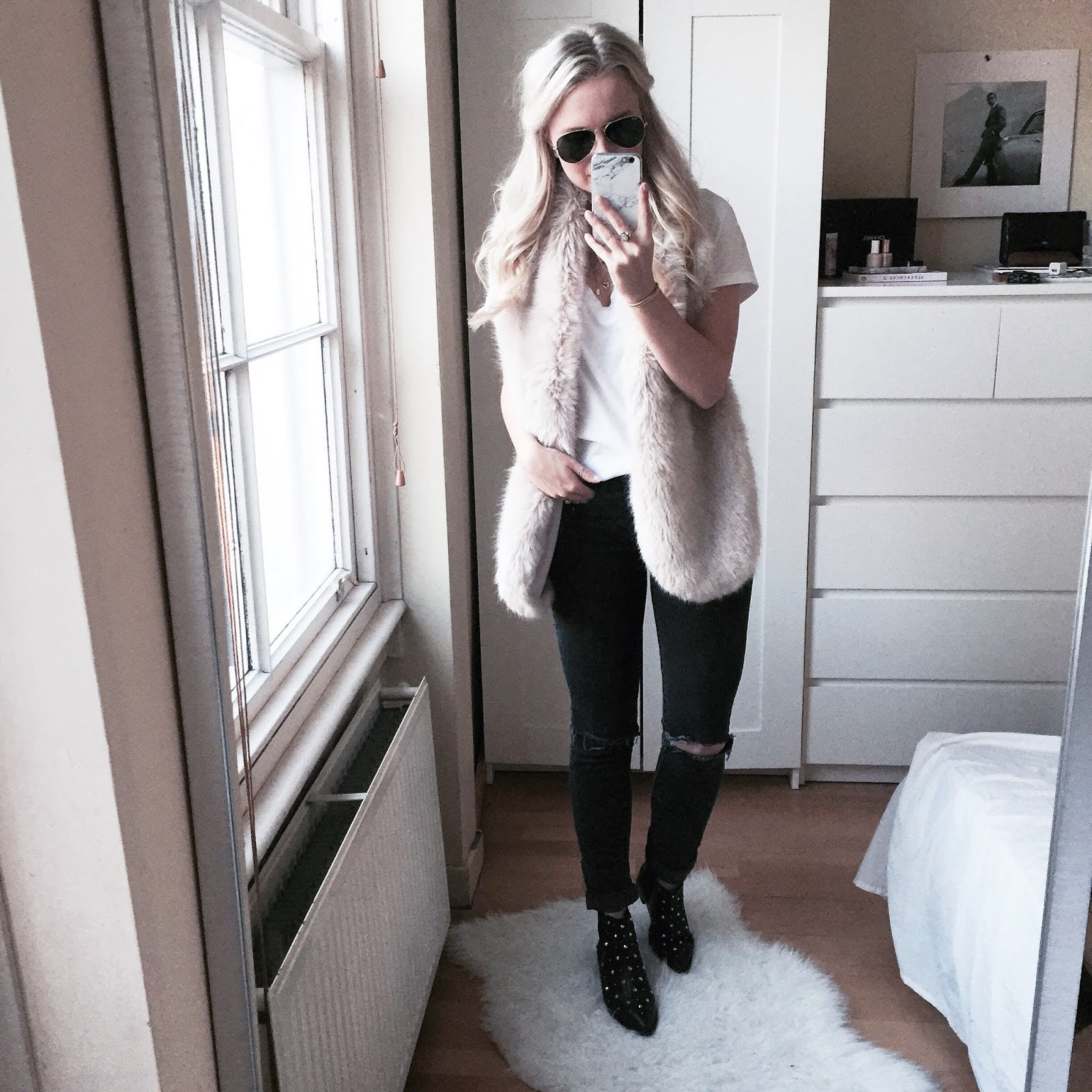 outfit of the day wearing ASOS black ankle boots and faux fur stole from Zara