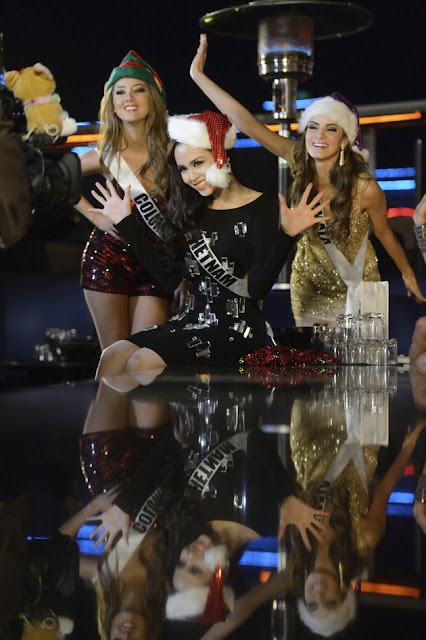 Miss Universe 2012 contestants Miss Colombia Daniella Alvarez Vasquez, Miss Vietnam Diem Huong Luu (C), and Miss Guatemala Laura Godoy (R) sing at Caesar's Pure Nightclub for a TV spot shoot in Las Vegas, Nevada December 11, 2012