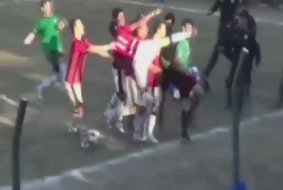 Marcos Leguizamón of Porvenir is seen launching a kung-fu kick into the referee's face