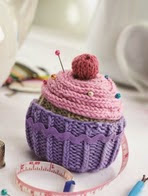 http://www.letsknit.co.uk/free-knitting-patterns/cupcake-pin-cushion