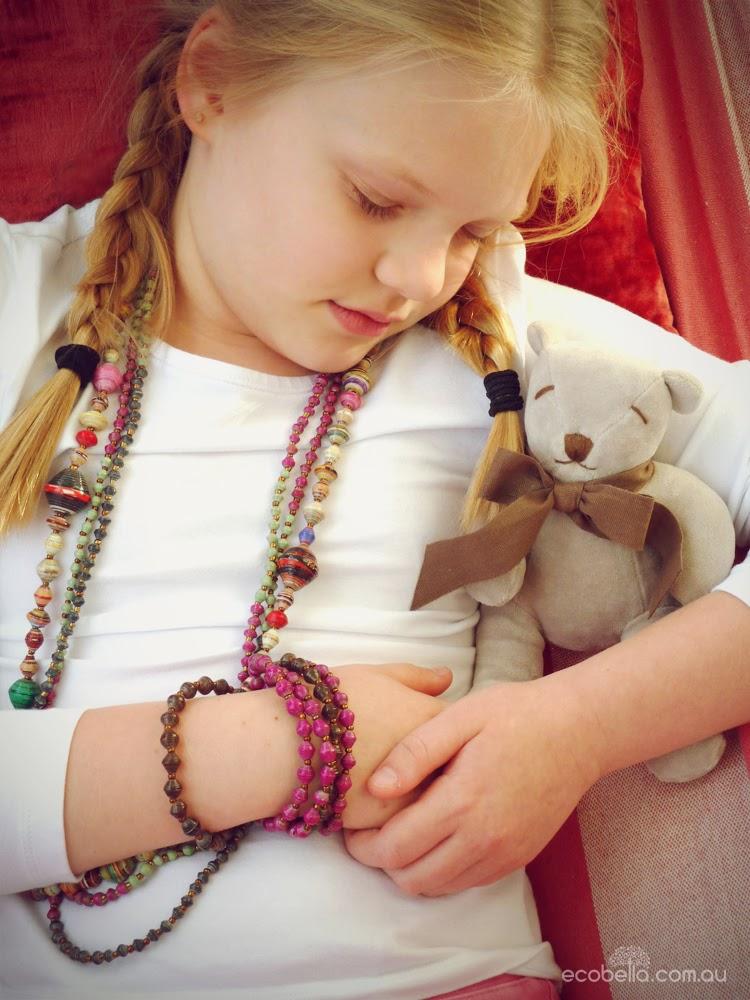 sleeping child with bamboo teddy bear