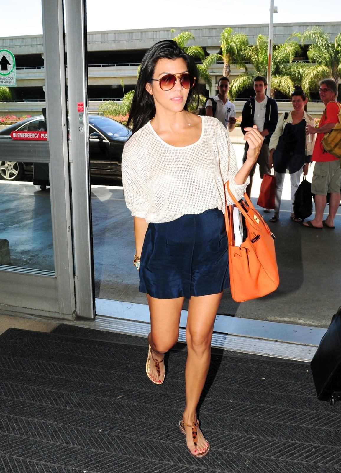 http://1.bp.blogspot.com/-CNtD-n5UPuI/T0vvovetmeI/AAAAAAAABKU/yzuE8lzgq-4/s1600/kourtney_kardashian_departs_lax_j0001_006.jpg