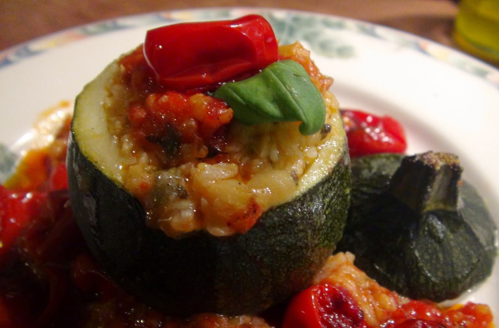my italian cuisine rice stuffed round zucchini courgettes with cherry tomatoes and basil. Black Bedroom Furniture Sets. Home Design Ideas