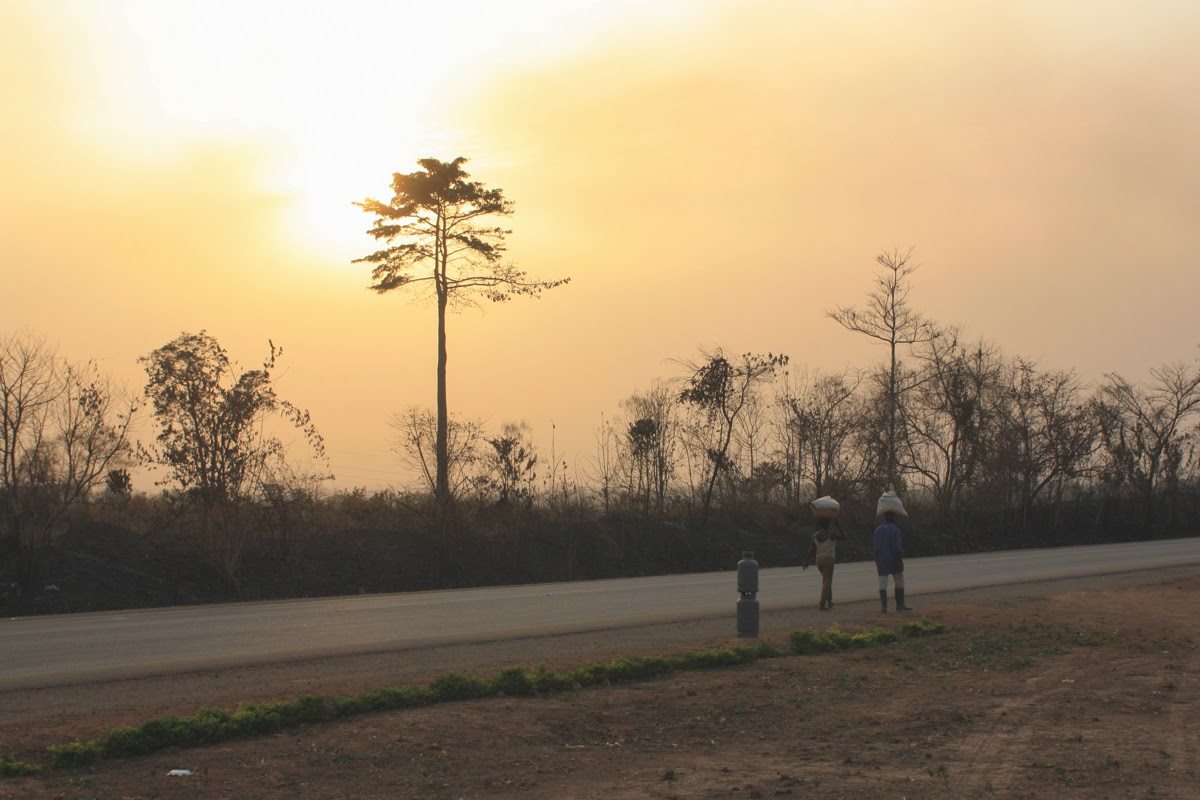 ghana plain road sunset