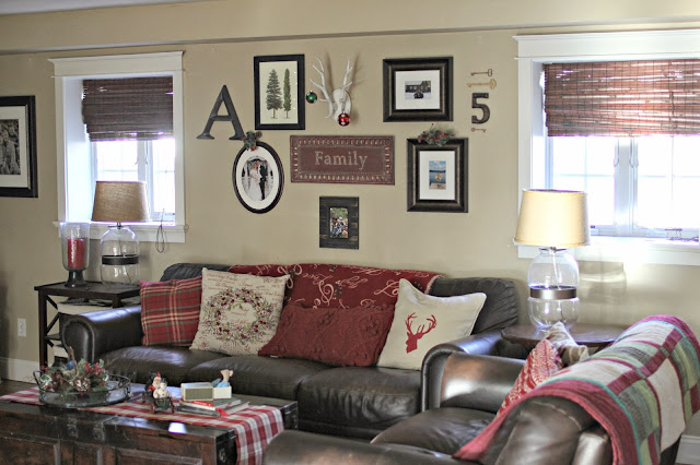 Gallery wall in family room with brown leather sofas and Crate and Barrel trunk coffee table-www.goldenboysandme.com