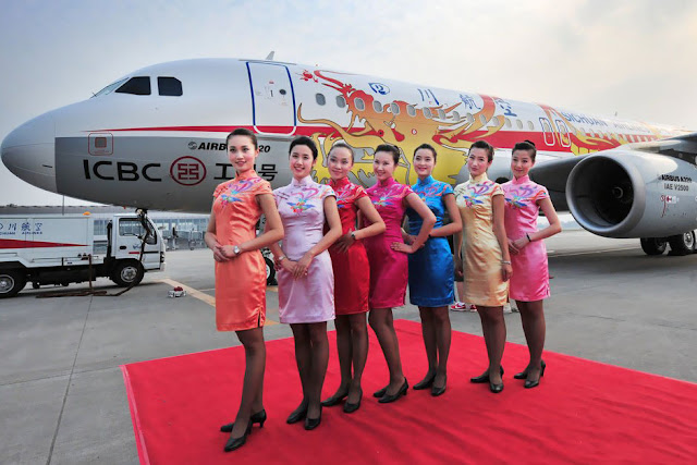 Sichuan airlines stewardesses in traditional chinese cheongsam style