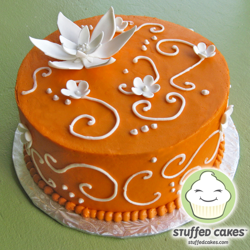 Stuffed Cakes Orange with White Blossoms Cake