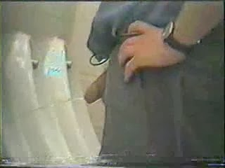 pissing Voyeuer urinal guys at
