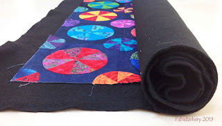 Making a Quilt Sandwich - Rolling Quilt and Wadding onto a tube