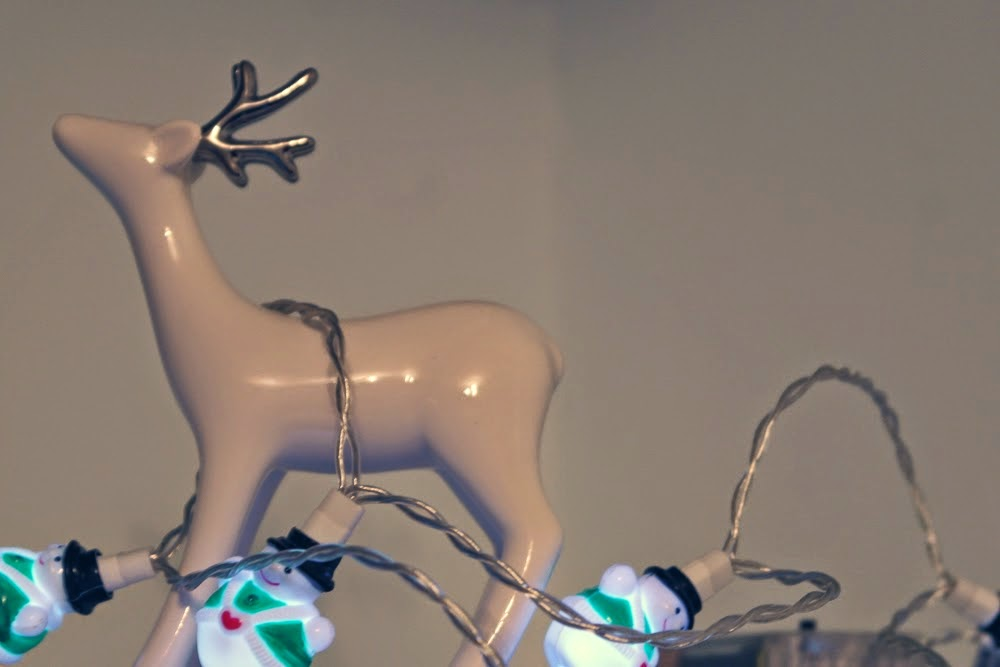 Deer figurine with snowman fairy lights