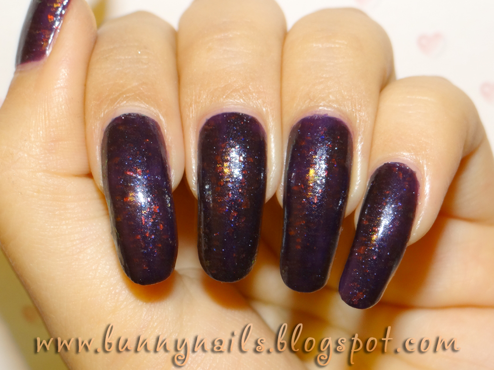 First, I painted my nails using a dark purple nail polish. I used Orly ...
