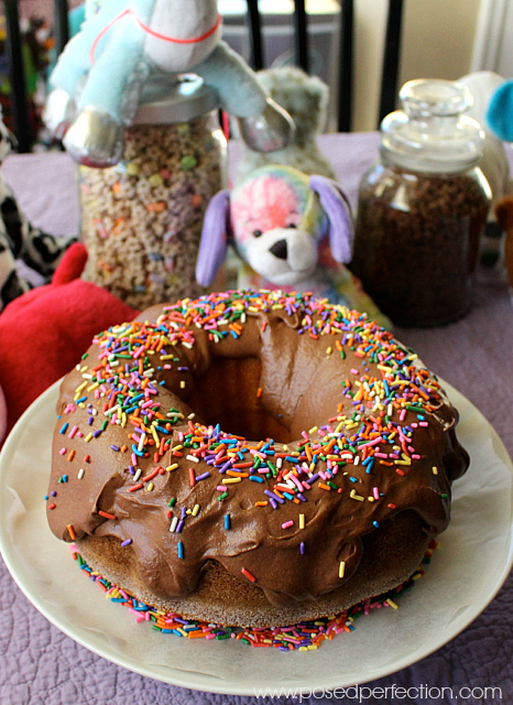 """Keep the decorations simple for your tween's """"unslumber"""" party. Donut cake, quilt for tablecloth and some stuffed animals."""