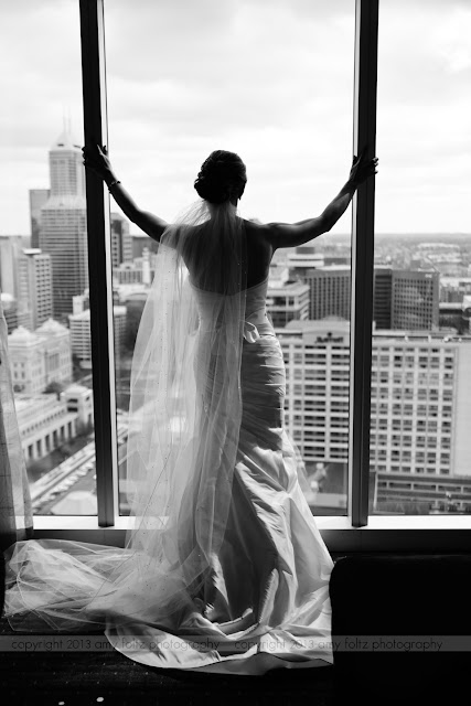 Bride looking out window in downtown Indianapolis