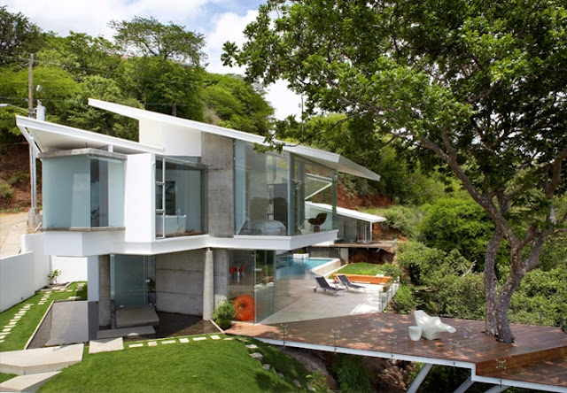Photo of an amazing modern home as seen from the elevated place nearby